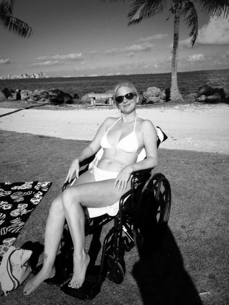 LaRae Lobdell after a car accident left her in a wheelchair for three months enjoying the Miami sunshine at Matheson Hammock Beach, Miami FL, November 2nd, 2015.